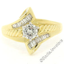 18K Two Tone Gold .90ctw Round Solitaire Diamond & Bypass Baguette Accent Ring
