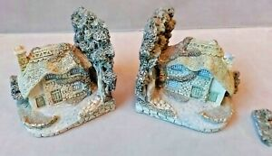 Pair of cottage shaped book ends.