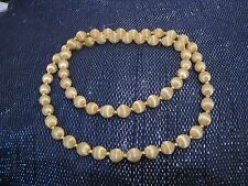 Very pretty string of cream coloured fabric beads gold tone mini space beads