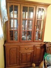 "Light Oak wood China cabinet /2 interior lights. 78"" x 49.5"", good condition."
