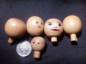 Wooden Dolls Heads.