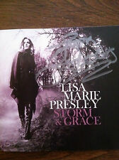 Storm and Grace  by Lisa Marie Presley signed autographed daughter to Elvis