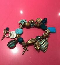 BN Gorgeous Designer Moah Blue/Brass Coloured Metal elasticated Charm Bracelet