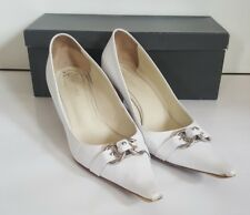Coccinelle White court kitten heels with toe detaling. size 6