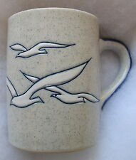 Seagulls in slight relief on a lightly speckled background Coffee Cup Mug