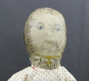 ANTIQUE  OIL  PAINTED  CLOTH  DOLL  with  YELLOW NECKLACE & CROSS
