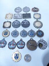 22 Médailles de natation.