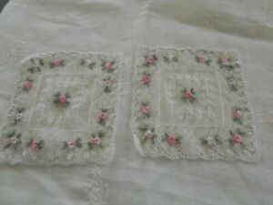 WHITE EMBROIDERED LACE APPLIQUES X 2 WITH PINK AND GREEN EMBROIDERY