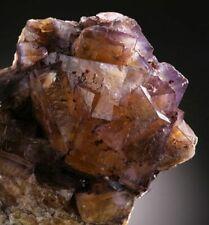 Rare Illinois fluorite specimen with bitumen inclusions features warm oranges