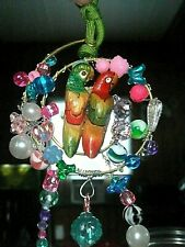 Love birds red crystal Sun catcher with suction cup. Hummingbirds love it