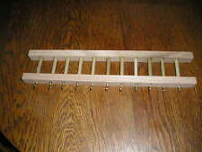 "Oak key and jewerly holder 12"" long by 2 1/2"" wide. clear coated"
