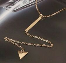 Triangle Dangling From A Long Bar Necklace Gold Toned