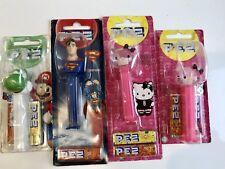 4 Pez Dispensers Superman, Hello Kitty,