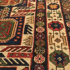 AN AWESOME  ANTIQUE CAUCASIAN RUG