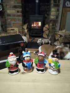 SET OF FOUR LED LIGHT UP COLOUR CHANGING CHRISTMAS FIGURE'S.