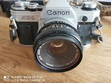 Canon AE1 35mm SLR Film Camera bundle with lenses, speedlite, case.