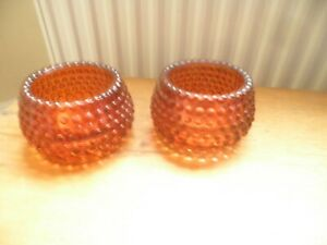 Pair of modern, heavy glass tea light holders, burnt orange.
