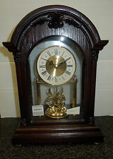 SEIKO MANTEL CLOCK IN WOODEN CASE WITH  3 ROTATING SWAROVSKI CRYSTALS QXN224BLH