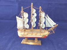 Simple Wooden Sailing Boat with Light Blue Sails Ornament.