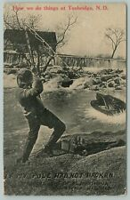 """How We Do Things"" at Tunbridge North Dakota~Fellow Snags Exaggerated Fish~1911"