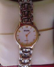 Reloj Duward Quartz para señora, correa de acero de doble tonalidad