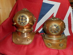 2 Copper and brass diving helmets.