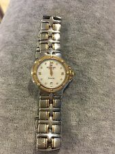 Raymond Weil women's watch. Stainless/gold with mother of pearl/diamond face.