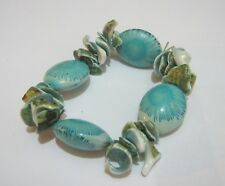 Lovely elasticated blue tones shell and oval bead bracelet