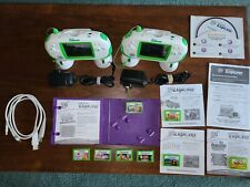 Two LeapFrog Leapster Explorers with Charging Bases, 8 Games and LeapFrog Tag