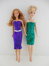 A Set of 2 Metallic Cocktail Dresses in Purple and Green Made to Fit the Barbie