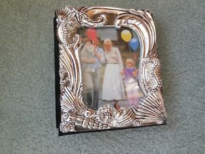 50 page shell  photo album holds 100 4x6 photos NEW by Godinger silver plate