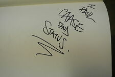An Autograph Album Page personally signed by CHASE AND STATUS.
