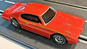 "Scalextric chassis custom fitted with Pontiac ""The Judge"" body."