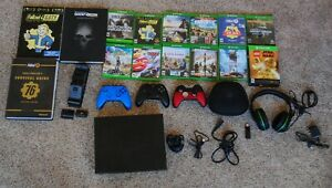 Xbox one x with 12 games, 3 controllers, wireless headset, 3 guide books, ect
