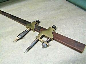 Trammel heads brass with fine adjustment. Beam compass. Scribe plus pencil.