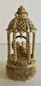 Vintage Max Factor Solid Perfume pendant . Gold colored metal birds in cage .