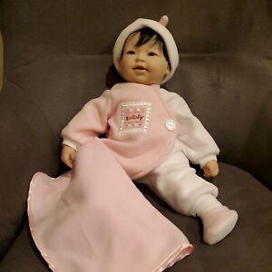 "Berenguer Boutique Baby Doll Black Hair Dark Eyes Soft Body 22.5"" with blanket."