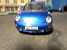 MAISTO  VOLKSWAGEN NEW BEETLE, REAL RUBBER TIRES           1:36  SCALE   5-11-14