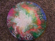 Black light acrylic pour painting on round canvas. Made by me on 11/15/2020