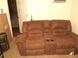 Leather Motion Loveseat recliner with console