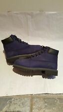 Original timberlands boots size 1.5 or eu 34 in a navy colour. Good condition.