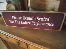 PLEASE REMAIN SEATED 4 ENTIRE PERFORMANCE  Bath sign