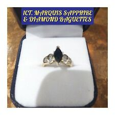 1CT BLUE MARQUIS SAPPHIRE FLANKED BY DIAMOND BAGUETTES IN A 14K YELLOW GOLD RING