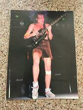 1981 VINTAGE MAGAZINE PHOTO CLIPPING WITH BAND AC/DC ANGUS YOUNG PLAYING GUITAR