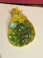 Vintage Yellow Plastic Cinch Bag With 29 Small Marbles & 1 Large Swirl Marble