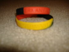 2) GERMANY SILICONE WRIST BANDS  (NEW )