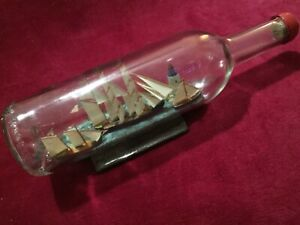 SHIP IN A GLASS BOTTLE WITH LIGHTHOUSE  11 1/2 X 3 1/2 inch