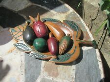 Carved and painted wooden fruit in hand carved painted leaf shaped wooden bowl