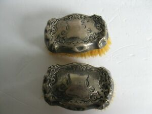 PAIR ANTIQUE STERLING SILVER NATURAL BRISTLE REPOUSSE GARMENT CLOTHES BRUSH WITH