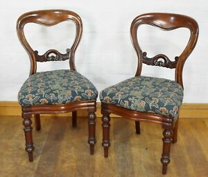 Antique pair of carved decorative Victorian Balloon Back hall / bedroom chairs